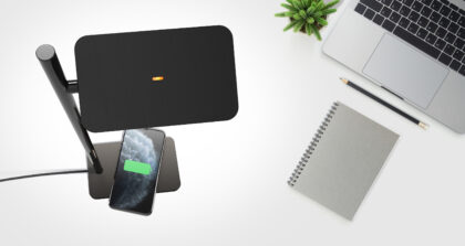 Creative flat lay photo of workspace desk. Top view office desk with laptop, pencil, notebook and plant on white color background. Top view with copy space, flat lay photography.